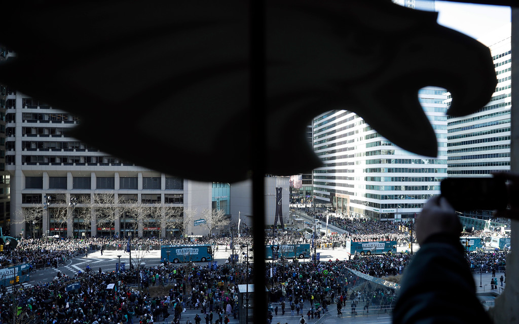 . A fan takes a photo as the Philadelphia Eagles parade up Broad Street during a Super Bowl victory parade, Thursday, Feb. 8, 2018, in Philadelphia. The Eagles beat the New England Patriots 41-33 in Super Bowl 52. (AP Photo/Matt Slocum)
