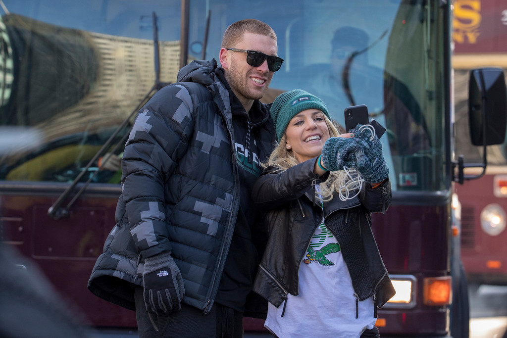 . Philadelphia Eagles NFL football player Zach Ertz, left, stops to take a photo with his wife, Julie Ertz, during a Super Bowl victory parade, Thursday, Feb. 8, 2018, in Philadelphia. The Eagles beat the New England Patriots 41-33 in Super Bowl 52. (AP Photo/Christopher Szagola)