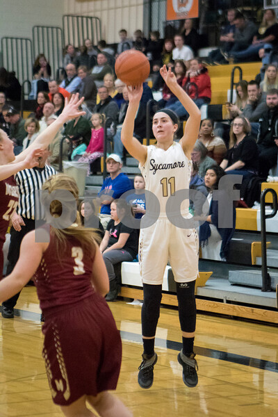 Sam Buckner for Shaw Media.<br /> Kate Majerus of Sycamore shoots a jump shot during their girls basketball game on Thursday, February 9, 2017 at Sycamore High School in Sycamore.