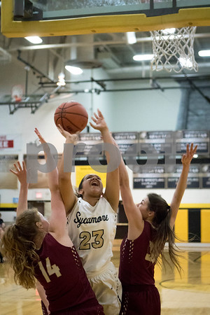 Sam Buckner for Shaw Media.<br /> Maria Wright of Sycamore throws up a shot while being fouled during their girls basketball game on Thursday, February 9, 2017 at Sycamore High School in Sycamore.
