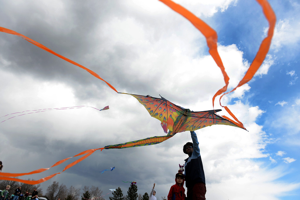 . Leo Price, 5, and his father Dale, of Westminster, try to get Leo\'s dragon kite in the air during the 12th annual Arvada Kite Festival held at the Stenger soccer complex in Arvada, Colorado, on April 6, 2014.  Hundreds of people braved cold temperatures , some rain and gusty winds to fly their kites  of all different sizes, shapes, and colors.  Activities included kite making classes and competitions for highest kite, smallest kite, largest kite and most visually appealing kite.  (Photo By Helen H. Richardson/ The Denver Post)