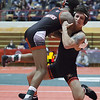 Jen Forbus - The Morning Journal<br /> Pioneer Brendon Fenton holds on tight to defeat Lancer Antoine Allen in the 120 pound division.