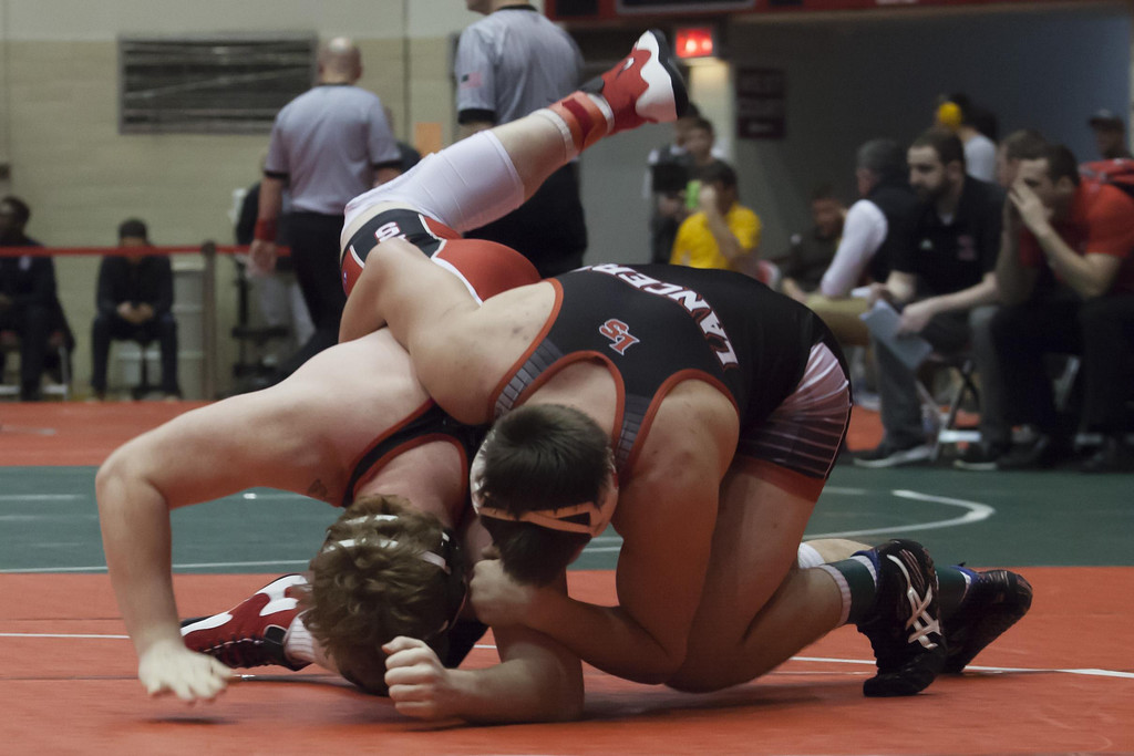 . Jen Forbus - The Morning Journal Elyria\'s Xavier Bell can\'t manage to get the upper hand against Cincinnati La Salle\'s Garrett Bledsoe in the 220 pound weight class.