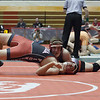Jen Forbus - The Morning Journal<br /> Andrew Levis of Elyria tries to work his way out of Michael Baker's grasp in the 195 pound weight class contest.