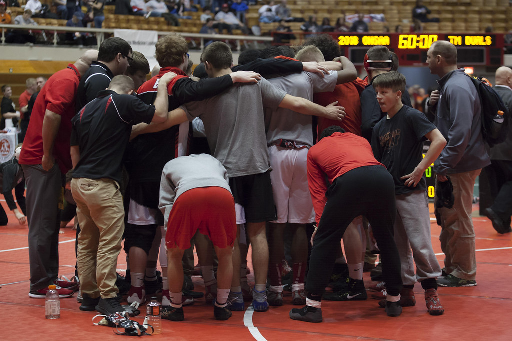 . Jen Forbus - The Morning Journal The Elyria wrestling squad gathers for a team powwow before the first round of the Dual Team State Tournament Sunday morning.