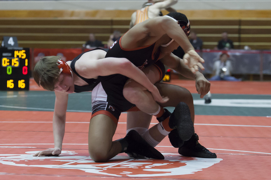 . Jen Forbus - The Morning Journal Elyria\'s Matt Zuckerman wraps up Cincinnati\'s Casey Wiles and the 132 pound weight class.