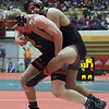 Jen Forbus - The Morning Journal<br /> Elyria's Lewis Aguilar tries to keep a good grip on his bout with Cincinnati La Salle's Blake Wilson in the 182 pound weight class.