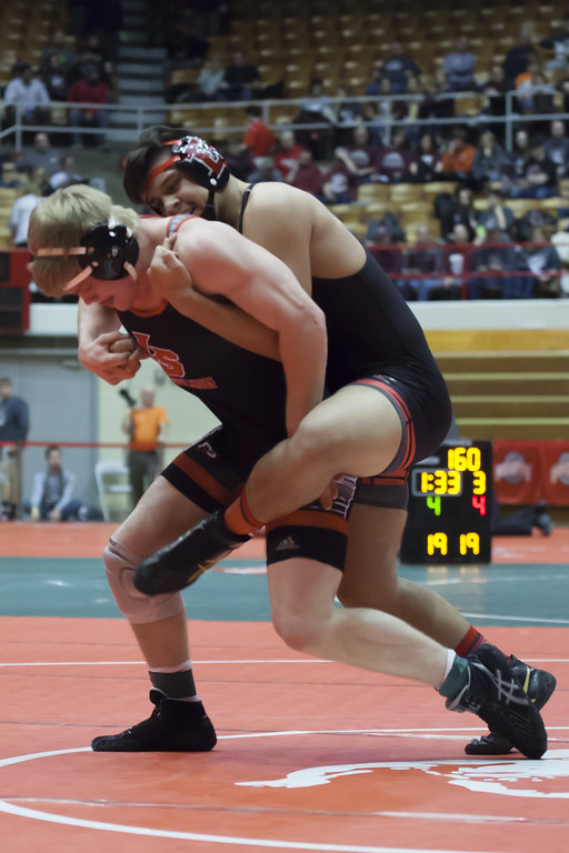 . Jen Forbus - The Morning Journal Elyria\'s Lewis Aguilar tries to keep a good grip on his bout with Cincinnati La Salle\'s Blake Wilson in the 182 pound weight class.
