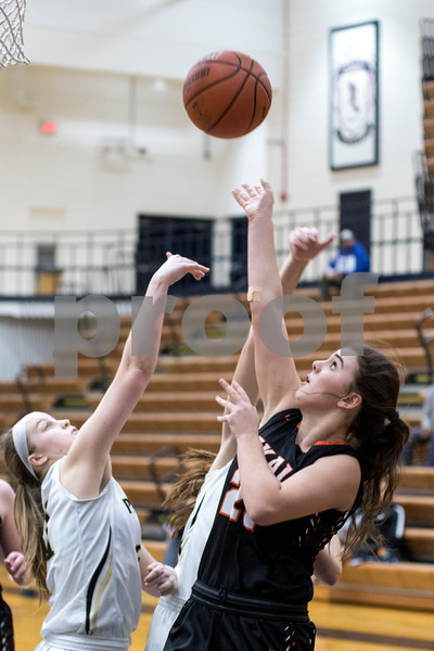 Sam Buckner for Shaw Media.<br /> Haley Westberg of DeKalb, right, shoots a layup in the 4A regional game against Glenbard North on Monday, Feb. 13, 2017 at James B. Conant High School in Hoffman Estates.