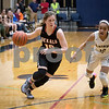 Sam Buckner for Shaw Media.<br /> Jacki Rapp of DeKalb, left, dribbles past Glenbard North's Zakiya Newsome on Monday, Feb. 13, 2017 at James B. Conant High School in Hoffman Estates.