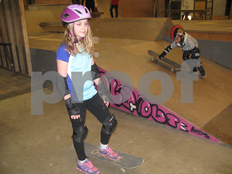 Aja Aspinwall, 9, waits her turn to skate Saturday at Fargo Skateboarding.