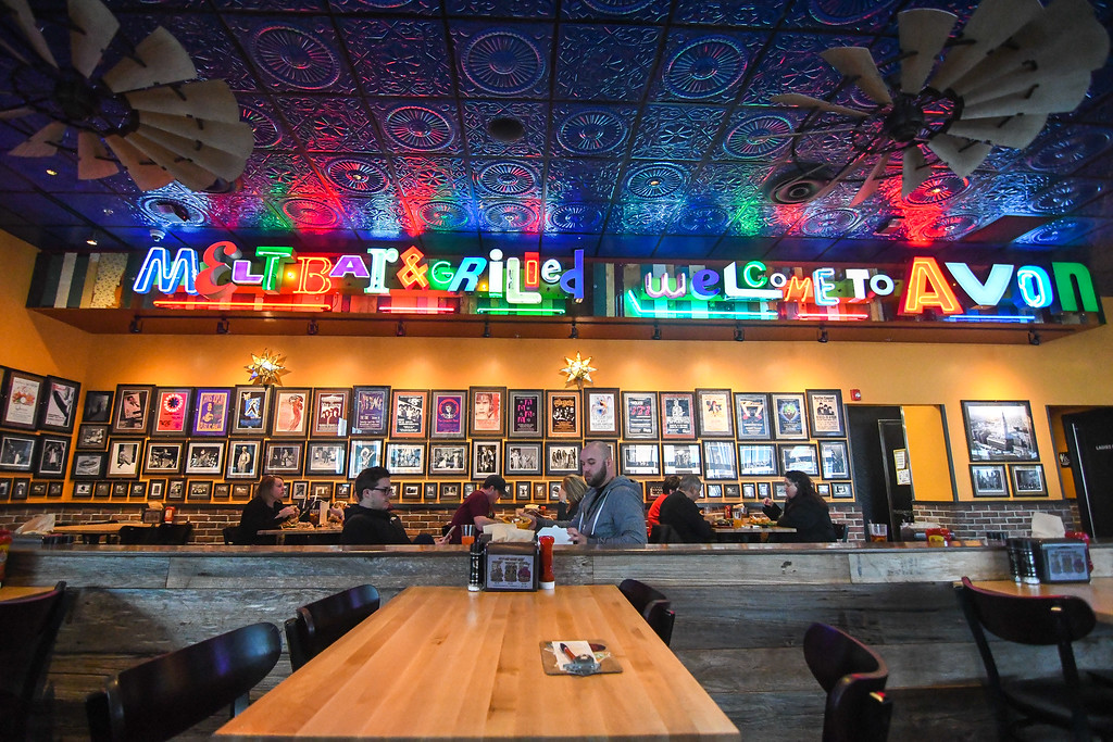 . Eric Bonzar � The Morning Journal <br>  Patrons dine under the neon lights of Melt Bar &amp; Grilled, 35546 Detroit Road, in Avon, Feb. 9, 2018.