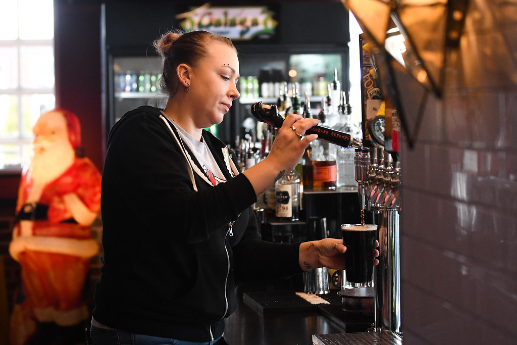 . Eric Bonzar � The Morning Journal <br> Bartender Jeni Ternes, of Elyria, pours a pint at Melt Bar &amp; Grilled, 35546 Detroit Road, in Avon, Feb. 9, 2018.