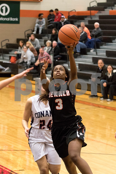 Sam Buckner for Shaw Media.<br /> Charlese Williams puts up a layup during the regional game against Conant on Monday February 12, 2018.