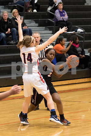 Sam Buckner for Shaw Media.<br /> Charlese Williams looks to pass the ball during the 3A regional game against Conant on Monday February 12, 2018.