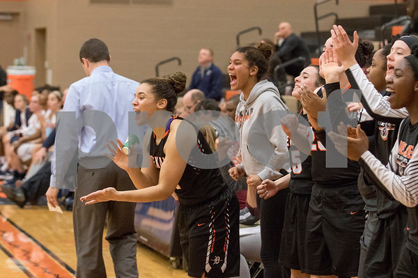 Sam Buckner for Shaw Media.<br /> The Dekalb bench cheers on Haley Westberg after making a layup while being fouled on Monday February 12, 2018.