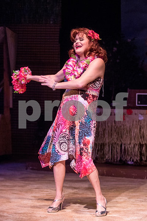 "Sam Buckner for Shaw Media.<br /> Christy Torian dances to a song while playing Ginger in Stage Coach Theatre's production of ""Gilligan's Island"" during the dress rehearsal on Tuesday February 13, 2018."