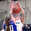 Sycamore's Kate Majerus is fouled by Burlington Central's Kathryn Schmidt during their IHSA class 3A regional semifinal on Wednesday, Feb. 16, 2017 at Wheaton Academy in West Chicago. The Spartans won 33-18.  Photograph by Jeff Krage for Shaw Media