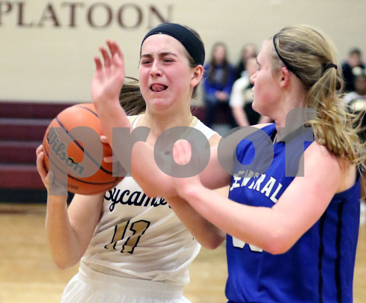 Sycamore's Kate Majerus drives toward the basket while defended by Burlington Central's Kathryn Schmidt during their IHSA class 3A regional semifinal on Wednesday, Feb. 16, 2017 at Wheaton Academy in West Chicago. The Spartans won 33-18.  Photograph by Jeff Krage for Shaw Media
