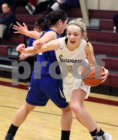Sycamore's Kylie Feuebach drives toward the basket around Burlington Central's Hannah Overmyer during their IHSA class 3A regional semifinal on Wednesday, Feb. 16, 2017 at Wheaton Academy in West Chicago. The Spartans won 33-18.  Photograph by Jeff Krage for Shaw Media