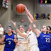 Sycamore's Emma Stice wins a rebound from Burlington Central's Maddie Menke during their IHSA class 3A regional semifinal on Wednesday, Feb. 16, 2017 at Wheaton Academy in West Chicago. The Spartans won 33-18.  Photograph by Jeff Krage for Shaw Media