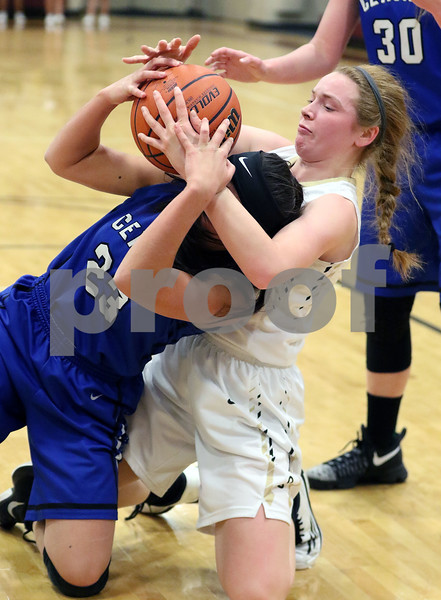 Sycamore's Juliet Mathey ties up Burlington Central's Maddie Drescher during their IHSA class 3A regional semifinal on Wednesday, Feb. 16, 2017 at Wheaton Academy in West Chicago. The Spartans won 33-18.  Photograph by Jeff Krage for Shaw Media