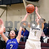 Sycamore's Kylie Feuebach takes a shot during their IHSA class 3A regional semifinal on Wednesday, Feb. 16, 2017 at Wheaton Academy in West Chicago. The Spartans won 33-18.  Photograph by Jeff Krage for Shaw Media