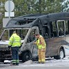 Mentor firefighters prepare to clean up the scene after putting out the fire which destroyed a Laketran bus on Route 306 in Mentor Feb. 15.<br /> Kristi Garabrandt - The News-Herald