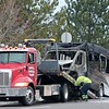 A tow truck operator prepares to tow the wreckage of a laketran bus after it caught fire on Route 306 in Mentor on Feb. 15.<br /> Kristi Garabrandt - The News-Herald
