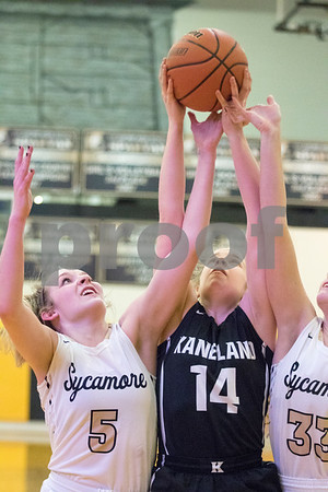 Sam Buckner for Shaw Media.<br /> Bryanna Kigyos of Kaneland and Kylie Feuerbach and Faith Reynolds of Sycamore go up for a rebound on Thursday February 15, 2018 at Sycamore High School.