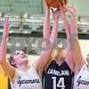 Sam Buckner for Shaw Media.<br /> Bryanna Kigyos of Kaneland and Kylie Feuerbach and Faith Reynolds of Sycamore go up for a rebound on Thursday February 15, 2018 at Sycamore High School.