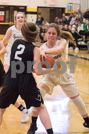 Sam Buckner for Shaw Media.<br /> Chloe Conley of Kaneland and Jacki Rapp of Sycamore fight for a rebound during the Regional game on Thursday February 15, 2018.
