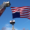 Carol Harper - The Morning Journal <br> American flag honors retired Elyria firefighter Mark Horton, who also served as a Sheffield Township trustee and as a secretary/treasurer for Ohio Professional Fire Fighters.