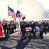 "Carol Harper - The Morning Journal <br> A flag draped casket bearing retired Elyria firefighter and Sheffield Township trustee Mark Horton was escorted to Engine 28 and honored by ""brothers and sisters"" in fire service with several honor guards and massed pipes and drums Feb. 18, 2017, at Elyria Catholic High School, 725 Gulf Road, Elyria."