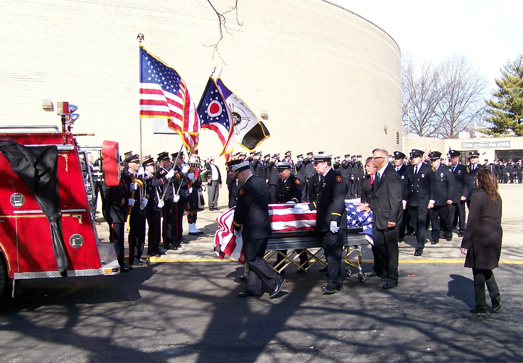 ". Carol Harper - The Morning Journal <br> A flag draped casket bearing retired Elyria firefighter and Sheffield Township trustee Mark Horton was escorted to Engine 28 and honored by ""brothers and sisters\"" in fire service with several honor guards and massed pipes and drums Feb. 18, 2017, at Elyria Catholic High School, 725 Gulf Road, Elyria."
