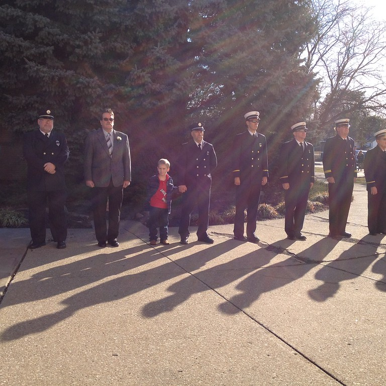 ". Carol Harper - The Morning Journal <br> Waiting as ""family,\"" as \""brothers,\"" for the funeral of retired Elyria firefighter Mark Horton."