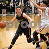 Sam Buckner for Shaw Media.<br /> Kate Majerus goes around the Stillman Valley defender on Monday February 20, 2017.