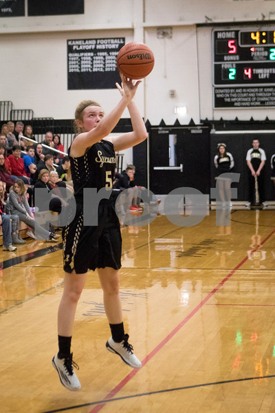 Sam Buckner for Shaw Media.<br /> Juliet Mathey shoots a 3 pointer on Monday February 20, 2017.