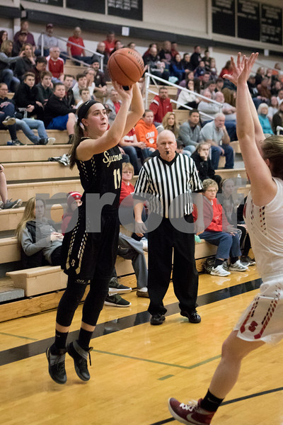 Sam Buckner for Shaw Media.<br /> Kate Majerus shoots a 3 pointer in a sectional game against Stillman Valley on Monday February 20, 2017.