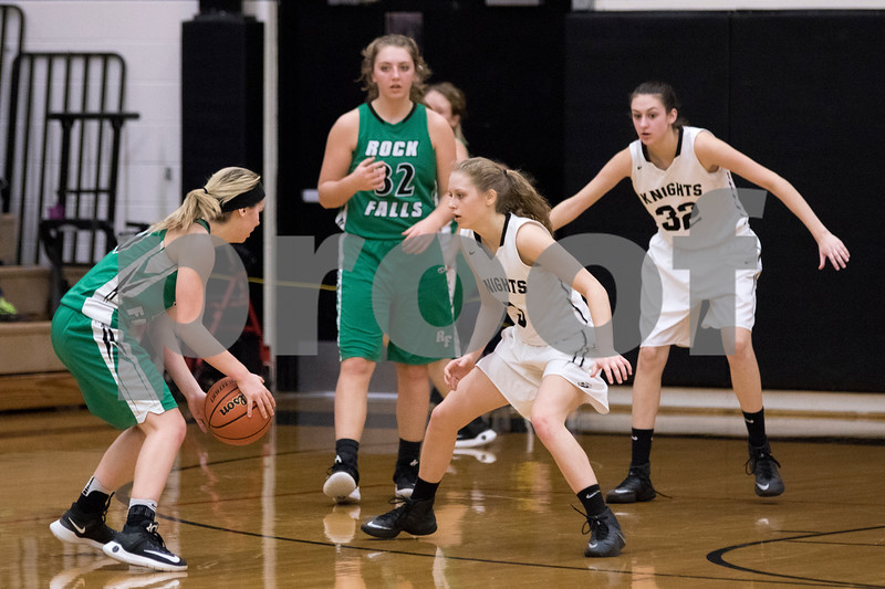 Sam Buckner for Shaw Media.<br /> Kaneland's Jamie Martens, center, and Adelyn Ringel, right, play defense against Rock Falls during their girls basketball regional semifinal game on Tuesday, Feb. 21, 2017 at Kaneland High School in Maple Park.