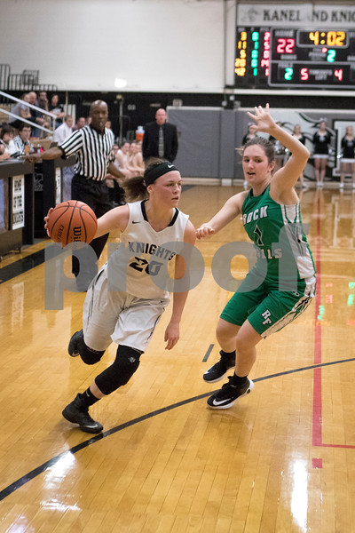 Sam Buckner for Shaw Media.<br /> Kaneland's Morgan Weber, left, dribbles past Rock Fall's Bailey Bickett during their girls basketball regional semifinal game on Tuesday, Feb. 21, 2017 at Kaneland High School in Maple Park.
