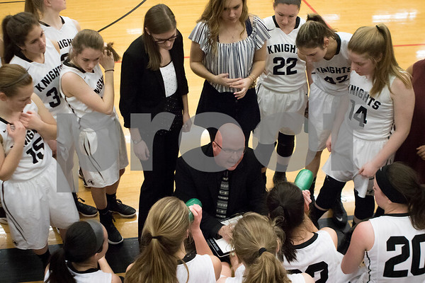 Sam Buckner for Shaw Media.<br /> Head Coach Ernie Colombe talks to his team after the first quarter during their girls basketball regional semifinal game against Rock Falls on Tuesday, Feb. 21, 2017 at Kaneland High School in Maple Park. Kaneland won 63-53.