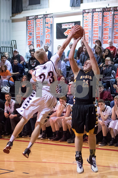 Sam Buckner for Shaw Media.<br /> Indian Creek's Kevin Jordal, left, blocks a shot by Adam Hart of Afton-Franklin Center during their regional semifinal boys basketball game on Wednesday, Feb. 22, 2017 at Indian Creek High School in Shabbona.  Indian Creek won the game 48-45 to advance to the regional final against DePue on Friday.