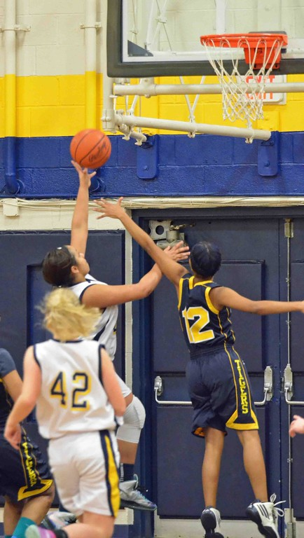 . Paul DiCicco - The News-Herald Wickliffe\'s Stephanie Martin driving to the hoop in the first quarter.