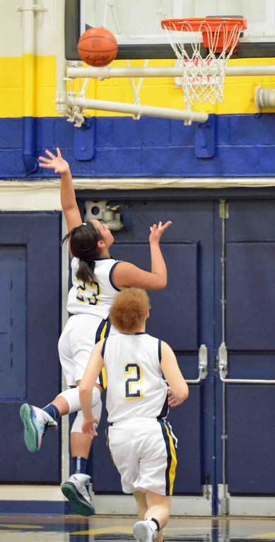 . Paul DiCicco - The News-Herald Wickliffe\'s Stephanie Martin shooting a layup after a steal, late in the first quarter.