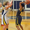 Paul DiCicco - The News-Herald<br /> Wickliffe's Nicole Carroscia defends the ball against Warrensville Heights on Feb. 22.
