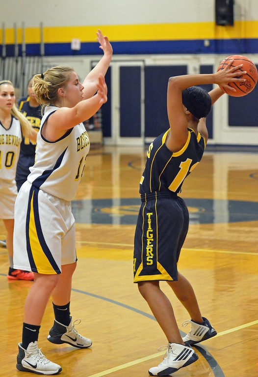 . Paul DiCicco - The News-Herald Wickliffe\'s Nicole Carroscia defends the ball against Warrensville Heights on Feb. 22.