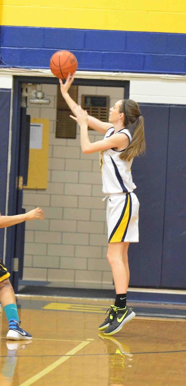 . Paul DiCicco - The News-Herald Wickliffe\'s Mary Burkett  shooting a jump-shot from just inside the arc.