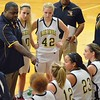 Paul DiCicco - The News-Herald<br /> Wickliffe's Head Coach, Anthony Wilson, talking strategy with his team at the end of the first quarter.