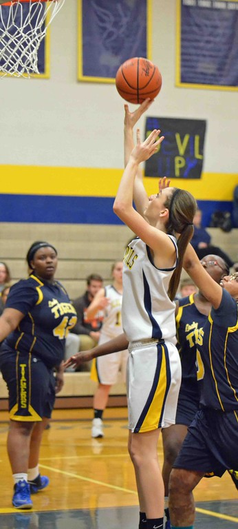 . Paul DiCicco - The News-Herald Wickliffe\'s Mary Burkett scores two points underneath against Warrensville Hts.